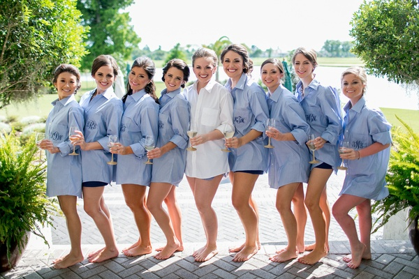 Bride in a white button-down shirt, bridesmaids in light blue, monogrammed button-down shirts