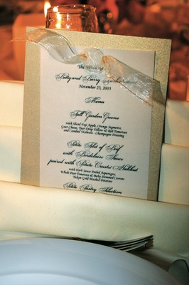 Ivory menu cards bordered by shiny gold card