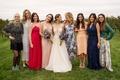 Brides in a line wedding dress with friends bridesmaid best friends mismatched dresses vineyard