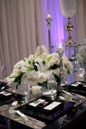 White lily, tulip, rose, and hydrangea flowers on mirror table