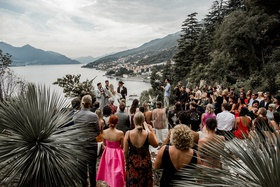 view of lake como from lugano switzerland wedding ceremony on cliff overlooking lake italy