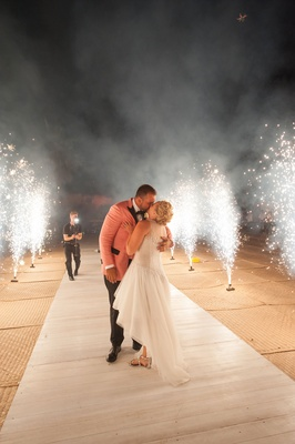 bride in mark zunino high-low wedding dress groom in salmon tuxedo jacket, fireworks