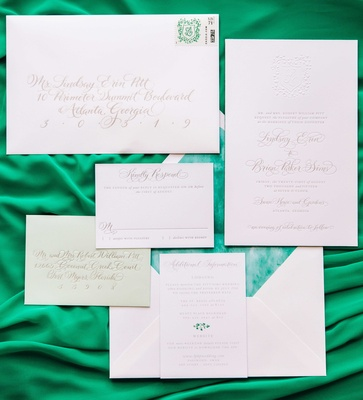 Wedding invitation suite green details response envelope, envelope liner, stamp