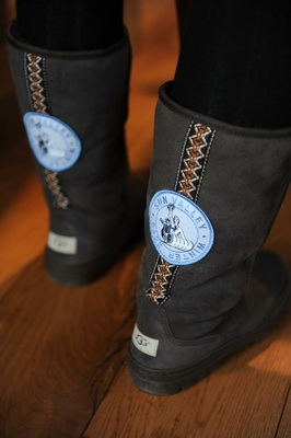 Black Ugg boots with native design and ski patch