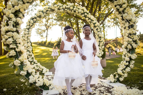 outdoor wedding ceremony ghana african royalty ivory hydrangea greenery circle arch outdoor ceremony