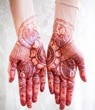 bride with henna tattoos and gold bracelet