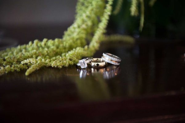 Emerald cut diamond engagement ring with two wedding bands