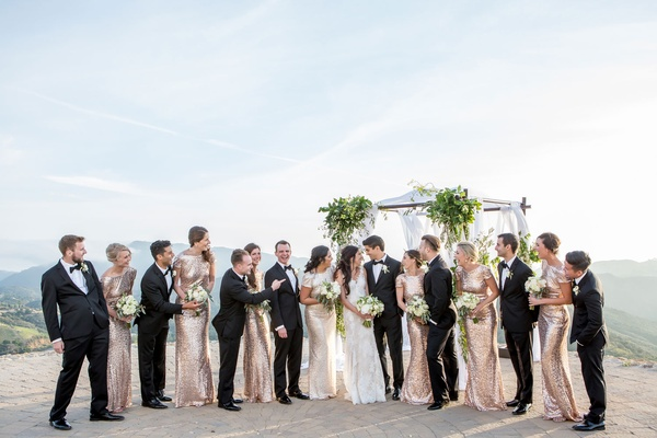 Bride and groom with bridesmaids and groomsmen sequin dresses tuxes views of Malibu mountains