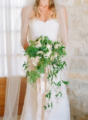 Wedding flowers handpicked bouquets for rustic bohemian ceromonies cascading white and green wedding bouquet with vines and white flowers mightylinksfo