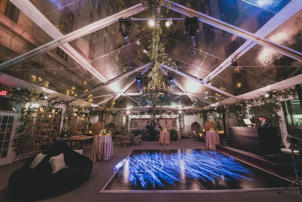 wedding reception dj antique furniture greenery garden vibe dance floor settees blue lighting