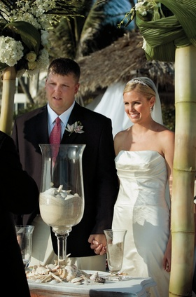 bride and groom stand at altar for sand ceremony