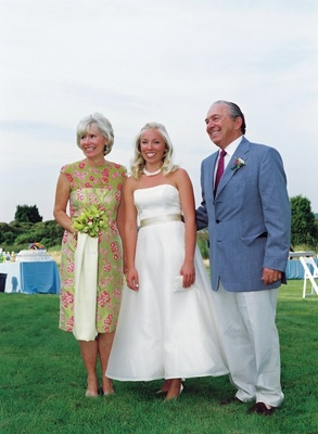 Bride in tea length wedding dress with preppy mother of bride dress