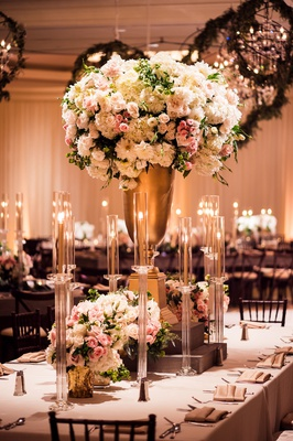 wedding reception flower chandelier greenery tall gold centerpiece white pink flowers taper candles