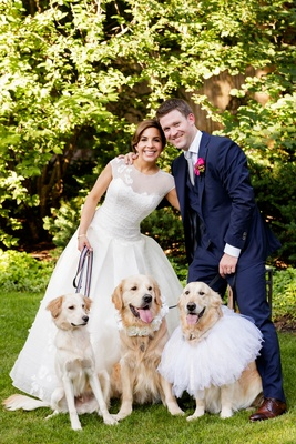 Bride in a line wedding dress groom in navy suit golden retriever dog flower girls ring bearers