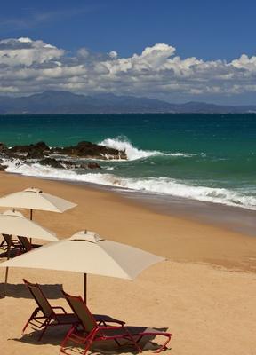 Beach chairs and umbrellas at W Retreat & Spa, Vieques Island.