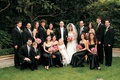Bride and groom with flower girl, ring bearer, bridesmaids, and groomsmen