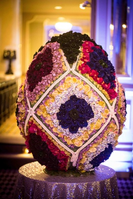 Fabergé egg made of flowers and pearls on pedestal