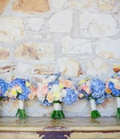 Large bride bouquet and smaller bridesmaid nosegays