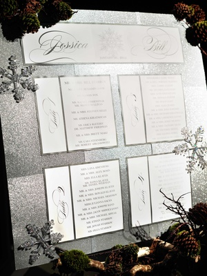 Silver glitter board with snowflakes and pine cones