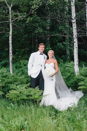 Wedding portrait photo bride in inbal dror strapless wedding dress groom in white tuxedo jacket