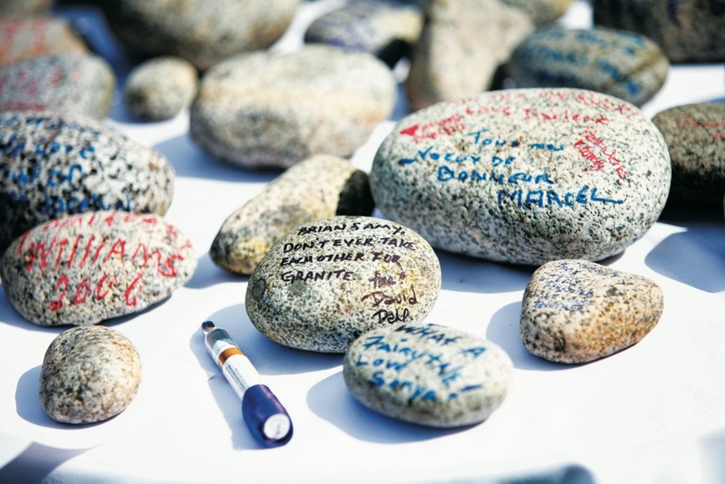 Wedding wishes written on river stones