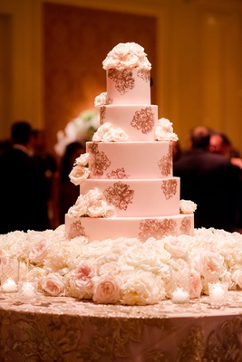 wedding cake with fresh flowers and rose gold stencil design peony candles