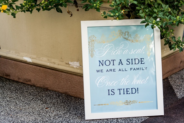 "sky blue ceremony sign for opening seating at wedding ""pick a seat not a side"""
