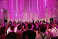 Wedding guests dancing in pink reception room