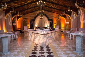 Wedding after party with light projections nightclub vibe diamond tile floor tufted furniture after