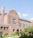 Exterior photo of the Church of Saint Joseph, Garden City, NY, on a sunny summer day