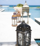 Decorative lanterns around a pool for an Indian engagement puja celebration