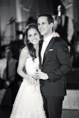 Black and white portrait of bride and groom at reception