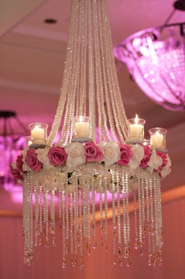 Chandeliers hanging from ballroom's ceiling