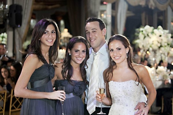 Twin sisters and groom with Champagne