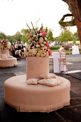 Wedding lounge ottoman with pink and white flower arrangement