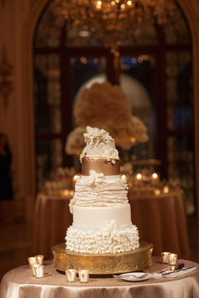 Wedding reception white ruffle and fondant wedding cake gold top layer and stand
