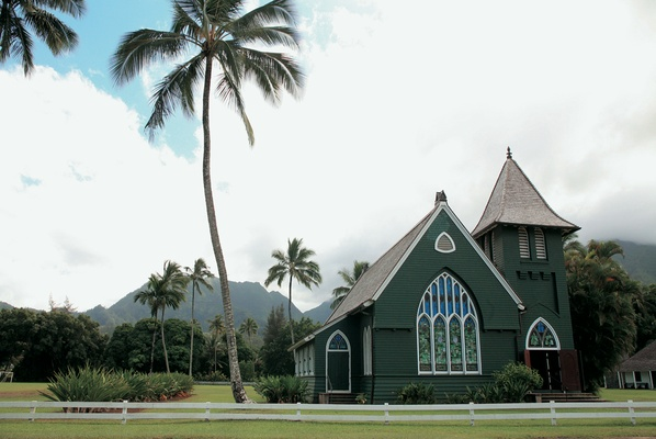 church in kauai with palm trees and mountain scenery