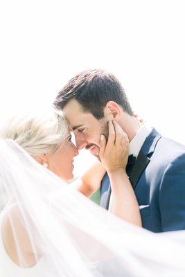 romantic wedding portrait ideas, bride and groom touching foreheads and staring at each other's eyes