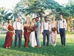 bride in lihi hod, groom in grey suit, bridesmaids in wine colored gowns, groomsmen in suspenders