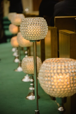 Unique lighting in different sizes along pews