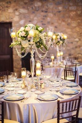 Silverleaf Club Tuscan-inspired wedding venue with stone walls, silver tablecloths, candelabra