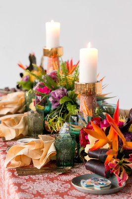 wedding reception table tropical styled shoot green glassware gold candlestick pink flowers