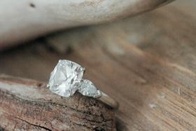Four prong three stone diamond engagement ring