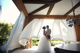 Bride and groom under canopy in Costa Rica