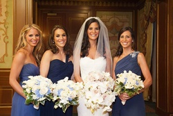 Mismatched bridesmaid dresses in shades of blue