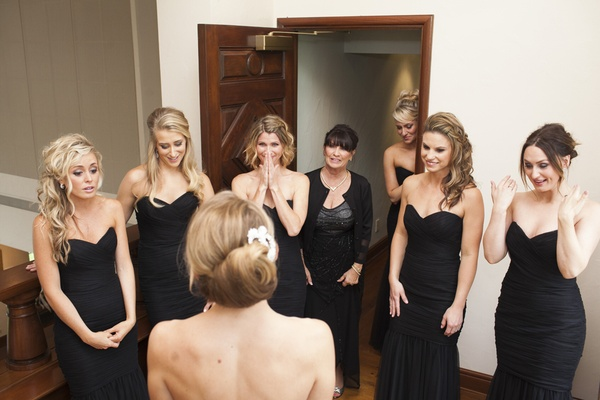 bridesmaids awe tears first look bride black dresses chic wedding classic girlfriends best friends