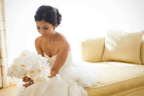 Persian woman in wedding dress with bouquet