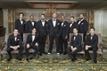 groom and groomsmen black tuxedos, groom in sneakers, groomsmen in dress shoes