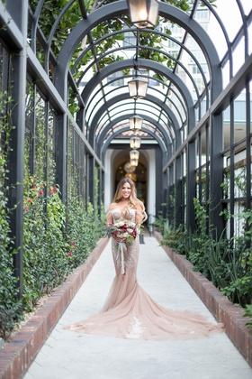 bride in blush champagne inbal dror wedding dress long hair highlights fall bouquet burgundy flowers