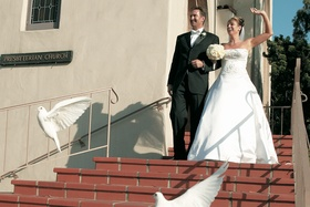 White dove release as newlyweds leave church ceremony